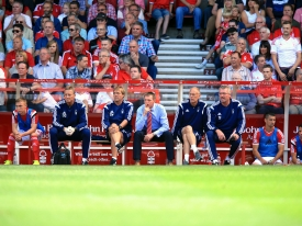 Former Nottingham Forest Manager, club and England Captain Stuart Pearce sat with management team in the Nottingham Forest John Pye Auctions sponsored match dug outs